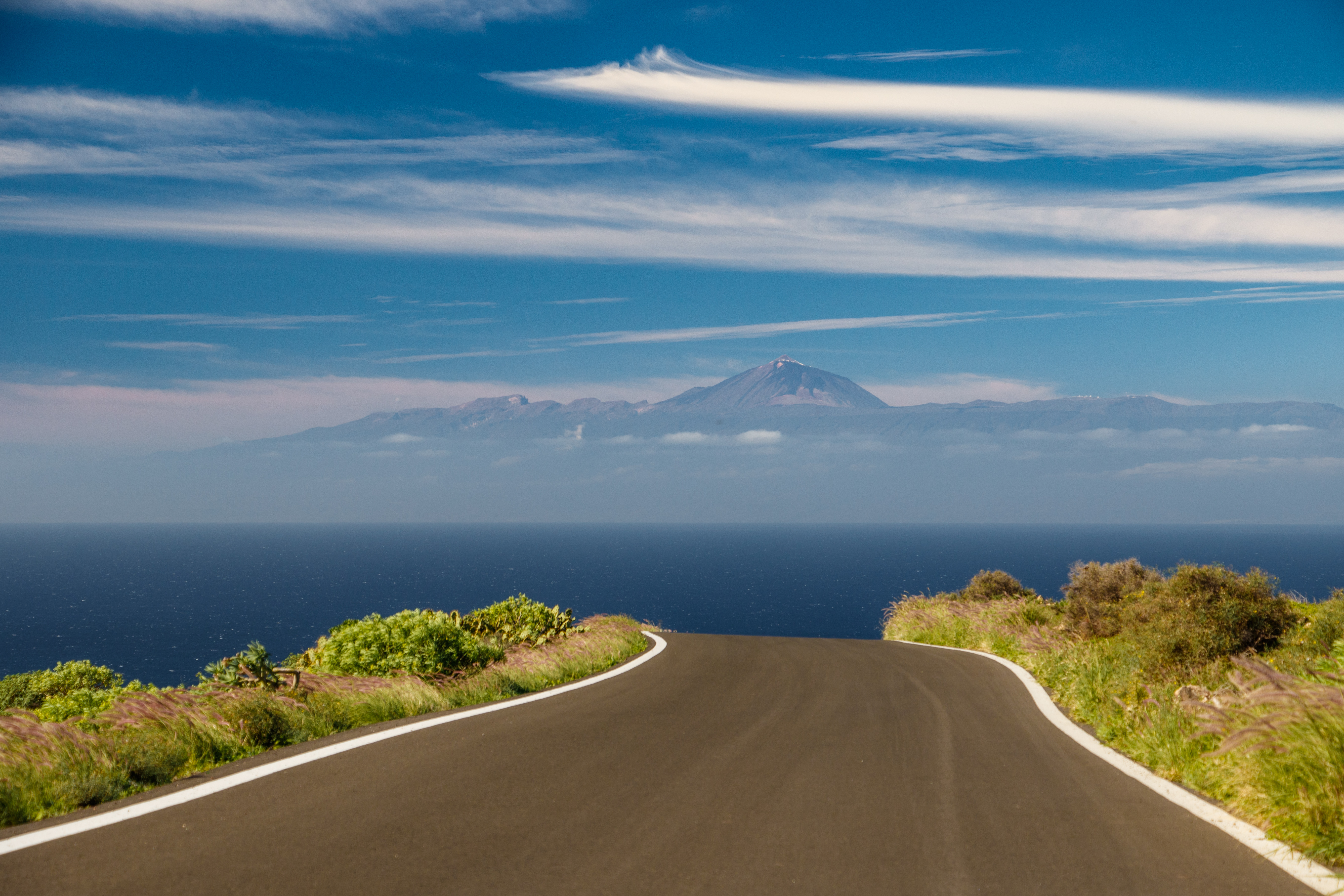 Teide on Tenerife sticking out in the sky above a rural road